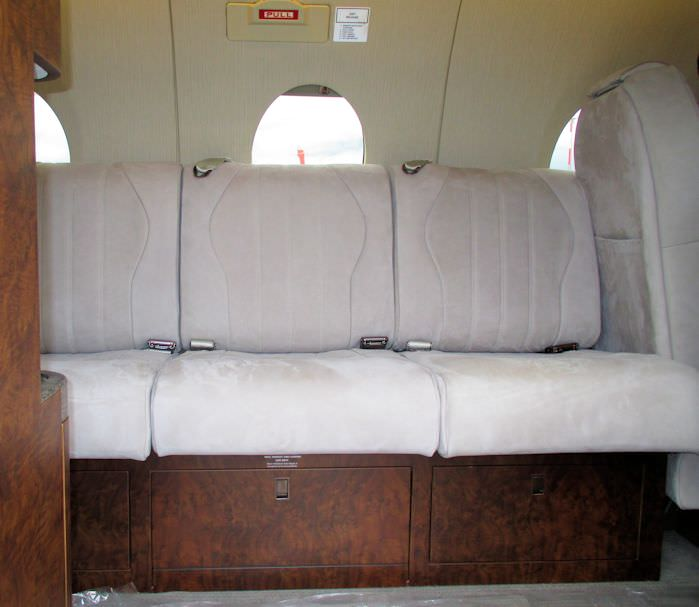 Nothing transforms the interior of the Beechjet 400 like a side facing divan.  While allowing additional passenger options, it also provides a more open, modern look to the cabin. This side-facing divan kit is  for installation in the Beechjet and Hawker B