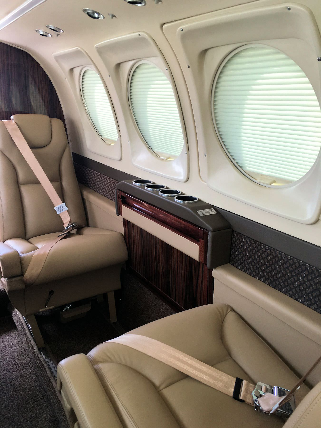 "This King Air 90 armledge table system adds functionality to your cabin and achieve that sought after ""new airplane"" look, and upgrade the cabin to the look and feel of the newest King Airs. The sidewall with integrated outboard armrest rail modernizes the"